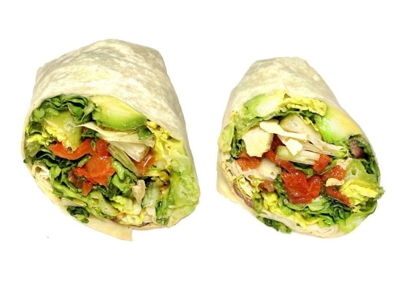 Pictured is a Manchester wrap! It consists on Romaine Lettuce, Tomato, Roasted Red Peppers, Avocado, Artichokes, Kalamata Olives & Swiss Cheese on a wrap.