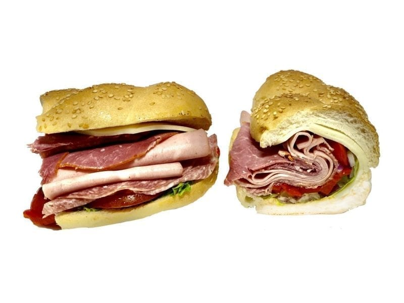 Pictured is our Sicilian sandwich. It consists of Boar's Head Salami, Capicola, Mortadella, Provolone, Lettuce, Tomato, Roasted Red Peppers, Pickles, & Onions drizzled with Olive Oil on a Braided Roll.