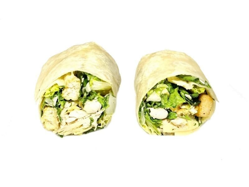 Pictured is our Chicken Caesar wrap with Grilled Chicken, Romaine Lettuce, Grated Parmesan Cheese, Garlic Croutons & Caesar Dressing.