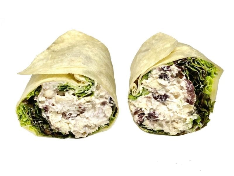 Pictured is our Country Harvest Wrap. It consist of Mixed Salad Greens & Cranberry Chicken Salad.