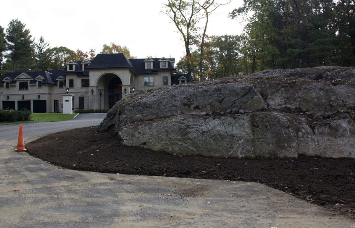 A before picture of a cul de sac middle that we recently landscape designed. It is covered in bare dirt.