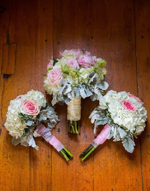 A selection of wedding bouquets with white and pink flowers created by our florist.