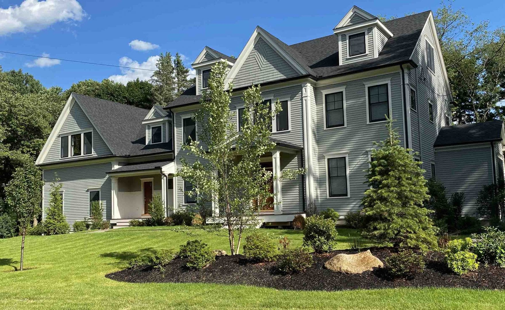 This picture displays the front yard of a recent landscape design project we worked on.