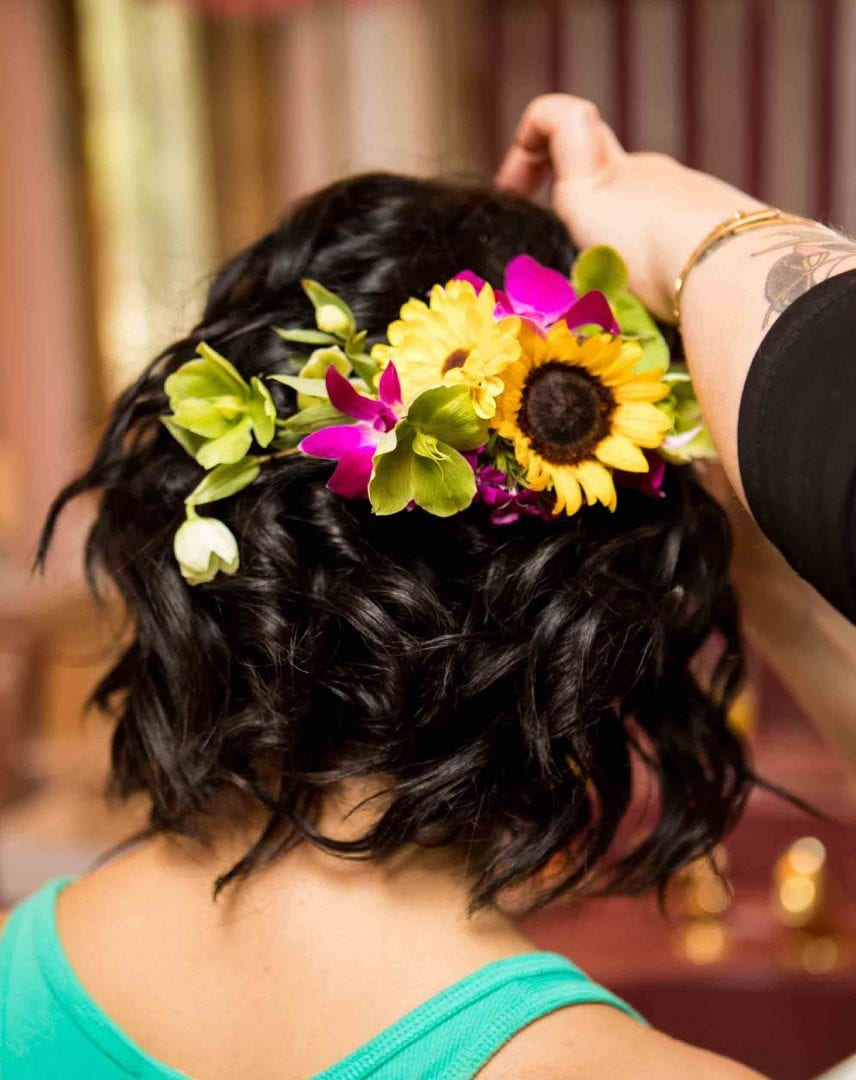 This picture displays a floral wedding headband created by our florist!