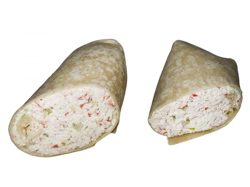 This picture shows our seafood salad wrap in front of a white background.